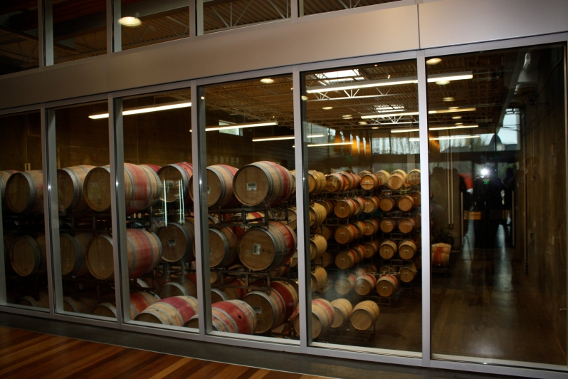 Barrels of wine aging in the open cellar at Novelty Hill/Januik