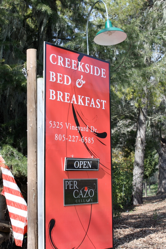 Sign at the entrance to Per Cazo and Creekside Bed & Breakfast