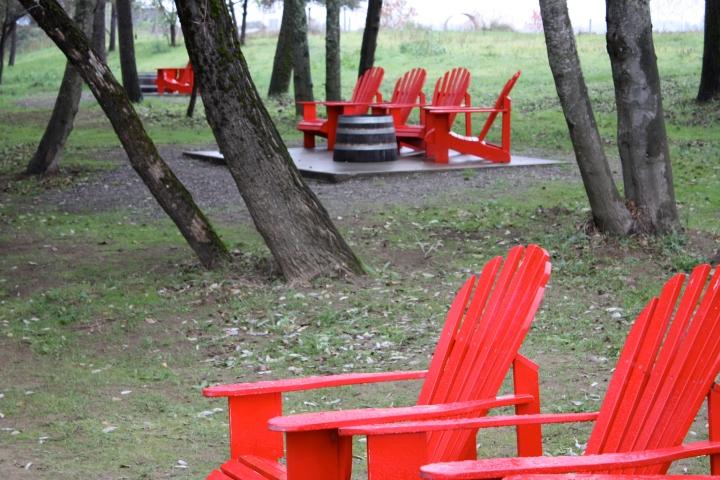 Truett-Hurst - Vibrant red chairs next to Dry Creek
